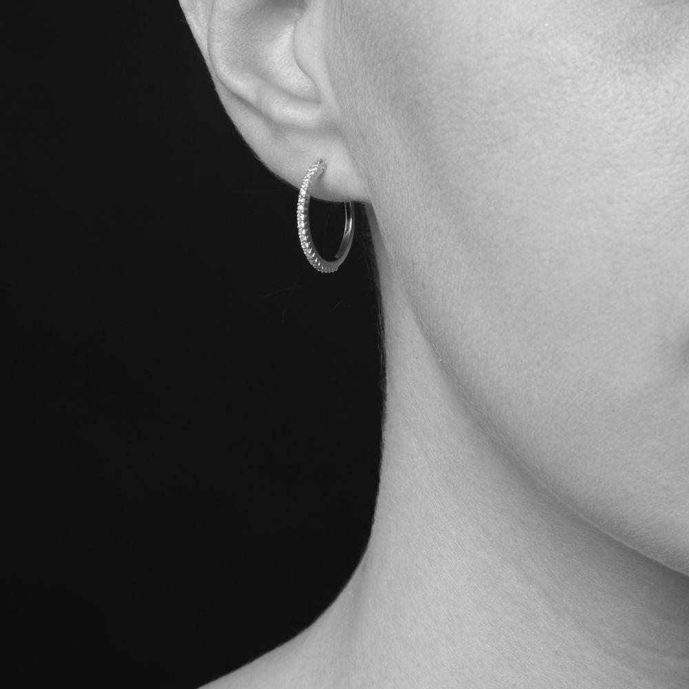 Model Wearing Bijou Solid 14k Micro Set Diamond Hoop Earrings