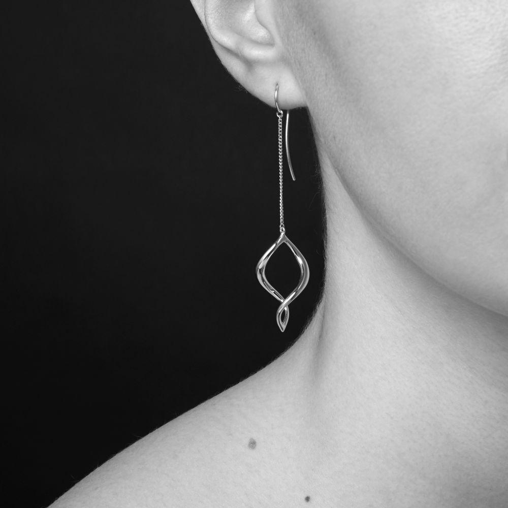 Model Wearing Dinny Hall Twist Small Chain Drop Earrings