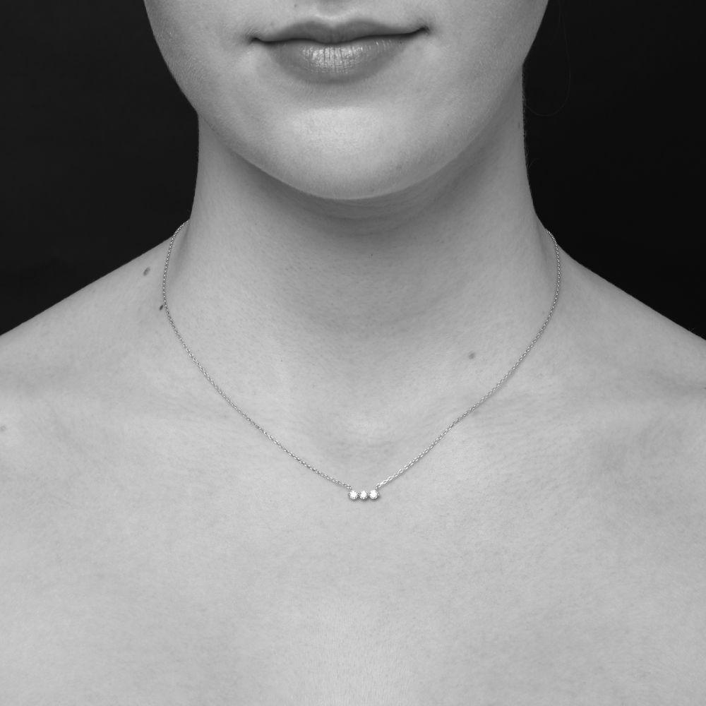 Model Wears Dinny Hall Shuga 14k three stone Diamond Bar Necklace