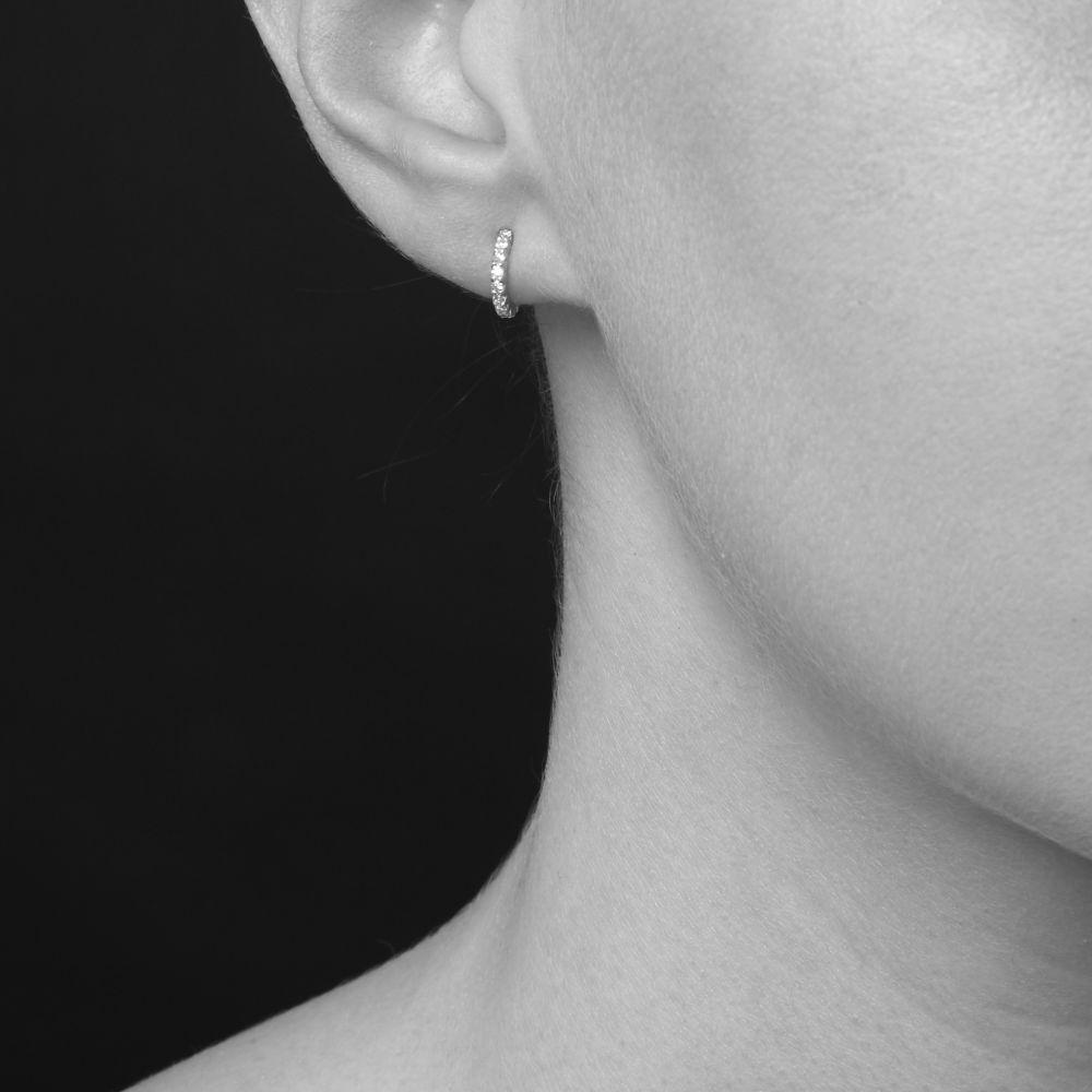 Model Wearing Bijou Solid 14K Mini Micro Set Diamond Hoop Earrings