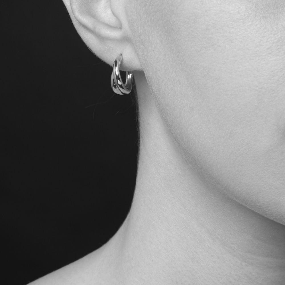 Model Wearing Dinny Hall Twist Mini Hoop Earrings